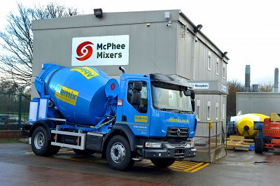 Blue concrete mixer outside McPhee Mixers