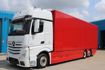 Red box body trailer with white Mercedes cab