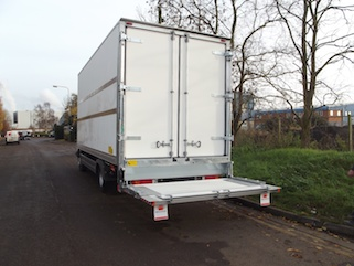 Extended tail lift on white box body