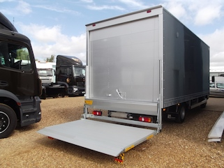 Lowered tail lift on grey box body trailer